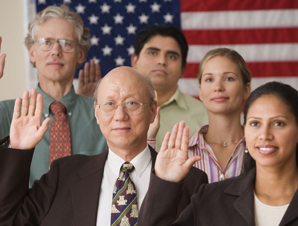 Group of people taking vow to become an american citizen